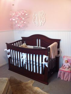 Pink and white nursery with bead board - like the bead board above the crib