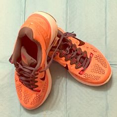 Nike shoes orange gray size 7 Nike shoes size 7 orange / gray lunarlon just worn 2x indoors comfy. My sister bought me a size 7 I'm a size 8 just a little dusty nice shoes❤️❤️❤️ Nike Shoes Sneakers