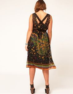 I liked this dress upon first glance, then I saw the back and loved it. Plus sized. Up to Size 22.