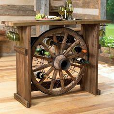 Suporte para vinhos feito com roda de carrroça