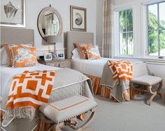 This is a accented room because it is mostly neutral colors and it just has an accent of orange in the blankets and pillows also in the skirts around the bed.