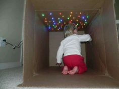 Poke holes in the top of a box and insert Christmas lights. Magical Cave!
