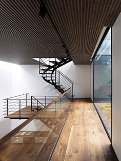 I like the long long expansive floorboards. It makes me want to do cartwheels across the floor. I also like the glass banister and the huge glass window.
