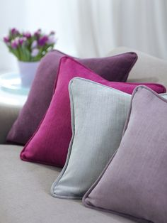 Purple, from lavender to dark aubergine, and saturations of purple layered with gray create a feminine color scheme.