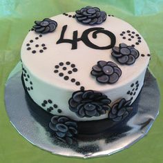 Like this one, but I don't know what the heck the flowers are made out of and Id have to get black fondant for the bottom part, and I don't have the tools for fondant, unless I used ribbon, that still leaves the flowers.