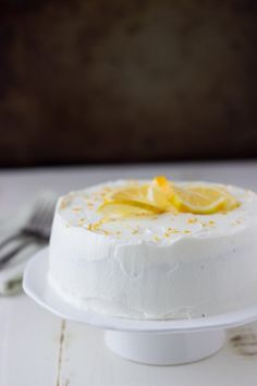 Meyer Lemon Cake with White Chocolate Mousse - a small scale soft lemon cake topped with whipped white chocolate mousse