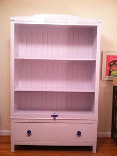 Bookshelf made from an old wardrobe.  Took the doors off and painted lilac for our daughter's room!