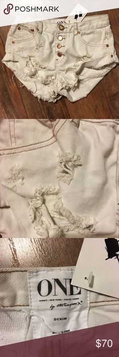 One Teaspoon white roll up distressed cutoffs One Teaspoon white roll up distressed cutoffs size 25 NWT. Perfect condition. No holds or trades. One Teaspoon Shorts Jean Shorts