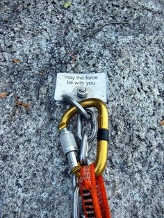 """Rock Climbing bolt message """"May the force be with you""""."""