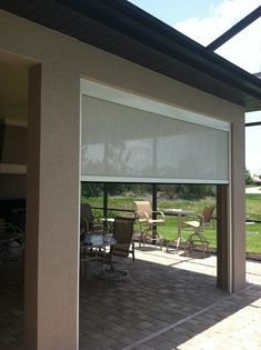 Roll screen to enclose patio by Marygrove Awnings