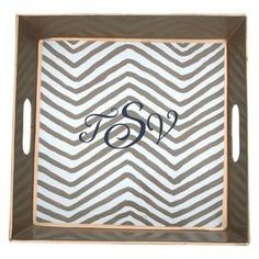 Letters will be printed in the order in which they are providedHand-painted bedside tray with chevron motif and contrasting trim. Crafted of recycled metal.Product: TrayConstruction Material: Recycled metal and paintColor: TaupeFeatures: Lead-freeDimensions: 2 H x 12 W x 12 DNote: Please type your initials in the order you would like them to appear. Letters on the left and right will be smaller than the middle letter.