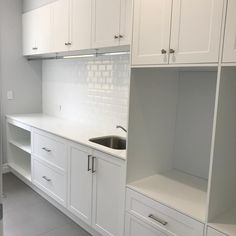 Laundry Sneak Peak Classic shaker cabinetry and beveled subway tiles at our Seven Hills Project Cabinetry // @kitchengallery1975 Tiles // @beaumont.tiles #laundry #laundryinspo #cabinetry #hamptons #hamptonsstyle #build #builder #building #buildingdesign #design #home #house #newhome #newlaundry #construction #architecture #interior #interiordesign #custom #customhome #custombuilt #custombuild #custombuilder #jux #juxdevelopments #juxdevelopmentsbuilders #designconstructrenovate