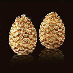 L'Objet Pinecone Salt & Pepper Shakers . $445.00. These luxury salt and pepper shakers will bring useful style to the table. Gold, platinum and Swarovski crystal are formed into tiny works of art that you?ll be proud to display.