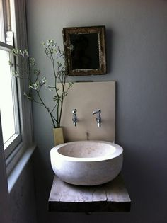 I came across this picture above of a make shift, but very cool bathroom on Greige that inspired me.  So funny, be...