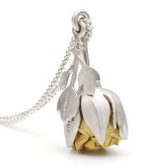 Victoria Walker - Rose Locket. 12 hand-formed 18ct gold Rose petals curl around the swirled centre of the flower. As the locket stem is pushed up, the petals emerge and unfold from within their contoured, silver 'sepal' casing. #Jewellery #KineticJewellery #Pendant #MothersDay #Gold #Silver http://directory.thegoldsmiths.co.uk/seasonal/mothers-day/#modal12