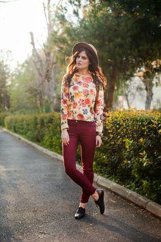Floral jumper, burgundy jeans, brown backpack