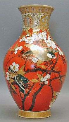 A Japanese Satsuma vase having a baluster form, with birds and flowering branch decoration on a orange background and brocade neck, Japan, circa 1876-1925