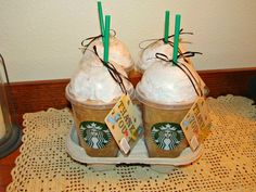 """Carol made the coolest, end of the year, THANK YOU gifts for Ben's teachers. These lattes are made with tan and white tissue paper in the cups with gift cards attached. The people at Starbucks gave Carol the cups and straws. """"Thanks a Latte!"""" My wife is sooo talented! (By Kirk and Carol Willis)."""