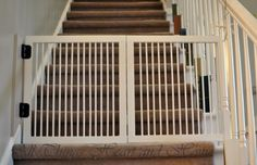 DIY gate for stairs - actually looks simple enough to do! baby gates, diy baby gate for stairs, fold gate, diy stair gate, diy gate and fence, babi gate, dog, kid