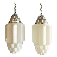 Pair of Large Art Deco Streamline Skyscraper Lamp Pendants   From a unique collection of antique and modern chandeliers and pendants at https://www.1stdibs.com/furniture/lighting/chandeliers-pendant-lights/
