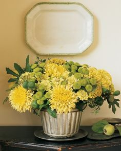 In the first weeks of fall, brisk air and frequent showers invigorate late-blooming chrysanthemums. Here, lush golden 'Revert' and chartreuse 'Yoko Ono' mums are supported by fig branches; zinnias, spearmint, and celosia are accents. A vintage pudding mol Fall Flowers, Fresh Flowers, Yellow Flowers, Beautiful Flowers, Yellow Flower Arrangements, Fall Arrangements, Chrysanthemum, Fresco, Fall Table