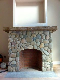 rock work idea for fireplace - like river rock, how close rocks re to one another and overall proportions (bookcase makeover fire places) Cottage Fireplace, Home Fireplace, Fireplace Remodel, Fireplace Design, Fireplace Mantels, Fireplace Ideas, Beach Fireplace, Fireplace Modern, Fireplace Decorations