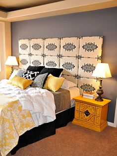 This upholstered headboard extends behind the bedside tables, creating the illusion of a bigger room.
