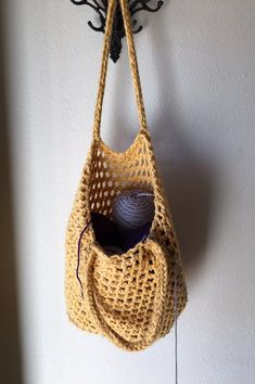 """This 15"""" x 12"""" tote bag is made using the Martha Stewart loom set. For added strength, it is knit using 3 strands of yarn as one. The purple"""