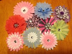 **HINT, HINT ladies! These cute little flowers are now available on soft headbands for newborns! Nothing gets the girls cooing at a baby shower quite like baby hair accessories do!