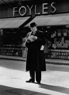 "© Wolfgang Suschitzky, Foyles, Charing Cross Road, London, 1936, ""Foyles was the largest bookshop in London at this time. It occupied two houses in the street of books, and was an appropriate background for the reading man"" --- more photos by suschitzky here: http://www.burnedshoes.com/tagged/wolfgang+suschitzky #bwphotography #blackandwhite #uk"