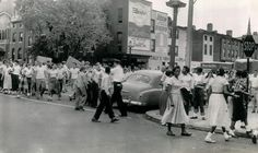 baltimore 1960s images | Baltimore City Police officer seperates whites and negro students