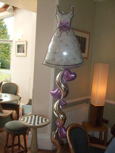 Wedding dress column of foil balloons