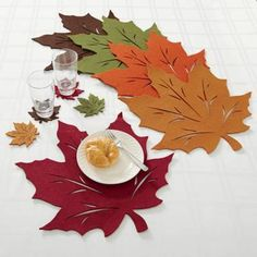 Add a crisp, autumnal look and feel to any table setting with the Felt Leaf Placemat. The chic placemat resembles a fallen leaf in rich, warm colors. Mix and match colors (each sold separately) for a festive look. Autumn Crafts, Thanksgiving Crafts, Thanksgiving Decorations, Thanksgiving Placemats, Linen Placemats, Tablecloth Fabric, Felt Leaves, Boho Home, Fall Decor