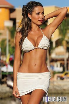 Playful Ruffles and banded thong bottom with skirt overlay. Perfect for enjoying the sun on the beach