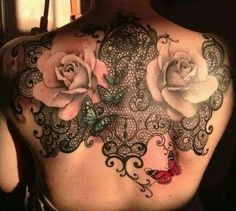 Butterfly and roses tattoo. Ink.