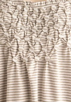 smocking with coins? buttons?