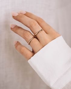 Looking for a dainty gold band to wear with anything? Then you've met your match with the Super Skinny Daylight Band. With a classic look, this band can be paired with almost any ring!