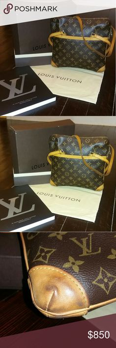 Louis Vuitton Monogram Canvas Sac Coussin GM Bag This bag was Extremely Gently Used, little signs of wear in the bottom corners, inside has no signs wear, very little signs of wear on the straps. Two corners on the box are detached. Dust bag included. A 233 page catalogue with all of Louis Vuitton's products. The original purchase receipt is also included. This bag was purchased at the Louis Vuitton in Boston, MA.  GUARANTEED AUTHENTIC!!!! Louis Vuitton Bags Shoulder Bags