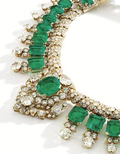 18 Karat Gold, Emerald and Diamond Necklace, Cartier, London The fringe necklace of Indian inspiration, set with 30 oval, cushion, emerald and step-cut emeralds weighing approximately 105.00 carats, accented by round, old European, old mine-cut and pear-shaped diamonds weighing approximately 46.50 carats, internal circumference 13 inches, signed Cartier, London; special order, 1947. With signed and fitted box.
