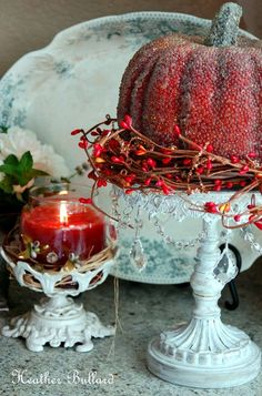 Decorative Pumpkin on Pedestal with Berry Wreath.  Absolutely love the red pumpkin - a beautiful color for the season.