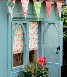 Summery garden shed - exterior shutters to close up for winter