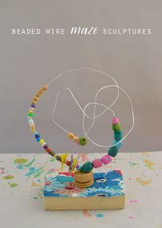 Kids make colorful beaded wire maze sculptures, reminiscent of artist Alexander Calder's work. A wonderful handmade toy!