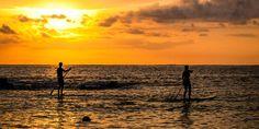Stand Up Paddeln im Sonnenuntergang