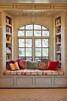 This is interesting - book cases inside nook.  But there's no place to lean back and actually use it - make North side book case start above head of seated person.