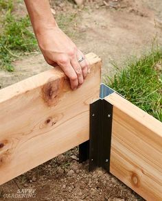 Raised bed ideas: Corners are a really easy way to set up a raised bed in an afternoon. #raisedbeds #raisedgardeningbeds