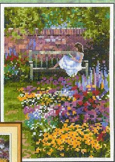 0 point de croix fille lisant ds le jardin - cross stitch girl reading in the…
