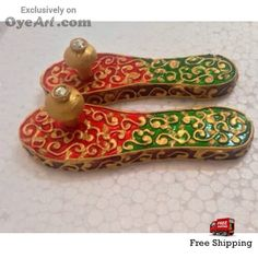 Get this hand painted #lakshmi paduka cut out on teak wood.. its a rare form of #painting known as #Meenakari painting. Buy here http://bit.ly/1GxZr73