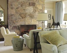Interesting use of space.  I like the way they made an area focusing on the fireplace.