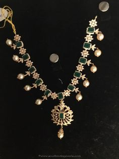Stunning gold CZ stone necklace embellished with emeralds and pearls. For inquiries please contact the seller below. Seller Name : Premraj Shantilal Jain Je Gold Earrings For Women, Gold Bridal Earrings, Pearl Necklace Designs, Stone Necklace, Gold Necklace, Gold Jewelry Simple, Gold Jewellery, Emeralds, Pearls