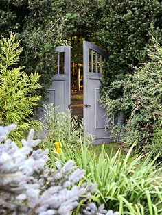 Adding a garden gate between distinctly different areas of your garden will literally stop you for a moment as you transition from, say, a bright, landscaped area into a dimly lit, mossy woods beyond.